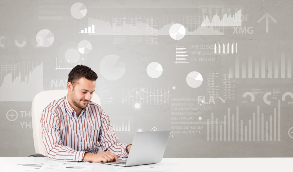 Business person sitting at desk with financial change, and report diagram concept-1